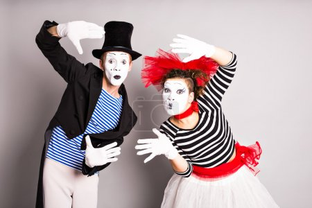 Waist-up portrait of funny mime couple with white faces. April Fools Day - concept