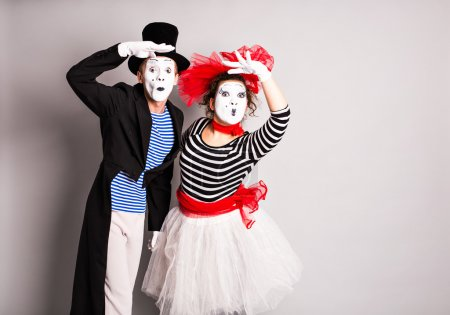 Street artists performing, Two mimes man and  woman in  April Fools Day