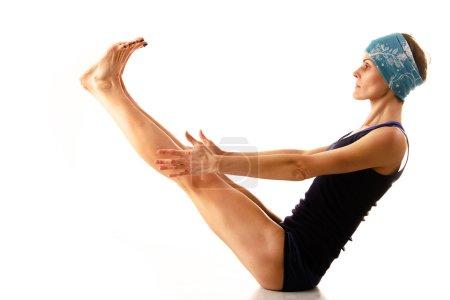 Beautiful young girl engaged in yoga, gymnastics, ...