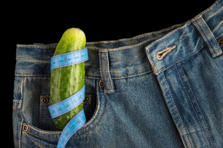 Big cucumber like the penis in the mens jeans, centimeter