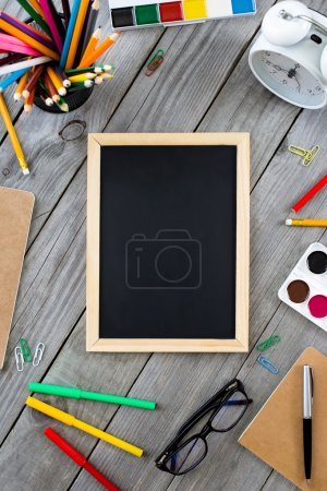 Small chalkboard in the frame school supplies