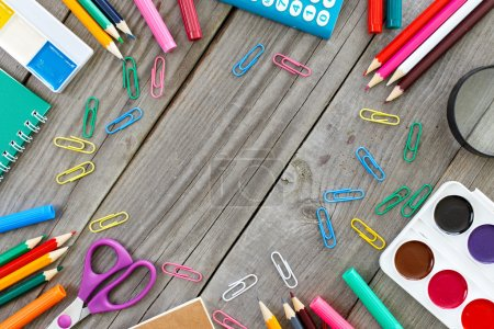 Frame with school supplies