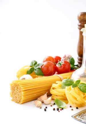Fettuccine and spaghetti on white background