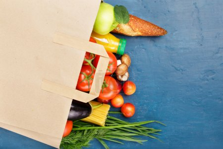Paper bag with different of vegetables and fruits