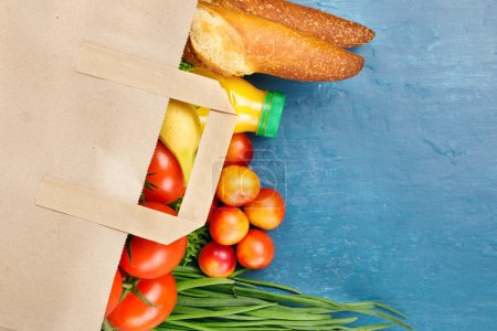 Full paper bag with different food