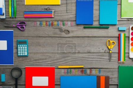 Set of school supplies on wooden table with copy space