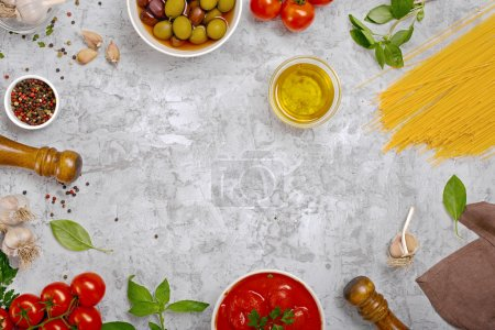 Photo for Set of ingredients for cooking Italian pasta on light surface with space for your text, top view - Royalty Free Image