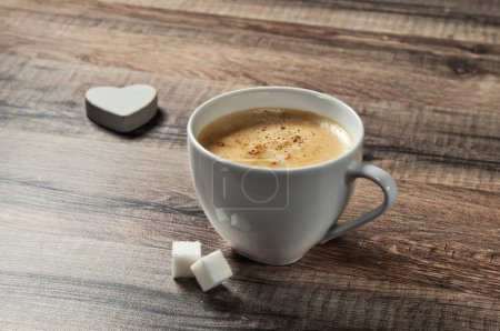 Photo for Cup of espresso coffee on a wooden table with sugar and wooden heart closeup. Top view. Copy space. Free space for text - Royalty Free Image