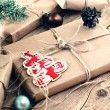 Christmas gifts on wooden table closeup. Rural or wooden style. Copy space. Free space for text. Top view. Toned in vintage style