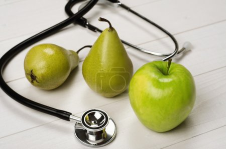 Fruits (apples and pears) with stethoscope
