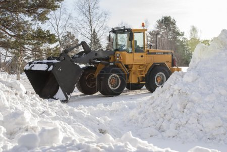 Tractor used for clearing roads of snow standing i...