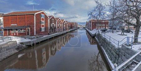 Photo for Old fishing warehouses in Hudiksvall, Sweden. fishing cottages, Sweden 's characteristic construction, traditionally painted buildings. Fishermen houses in the center of Hudiksvall - Royalty Free Image