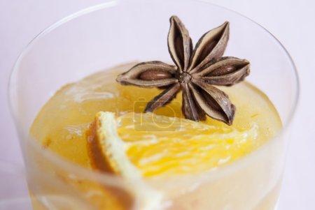 tiramisu dessert with jelly and a piece of orange
