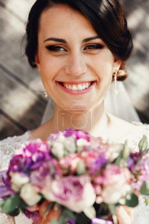 Beautiful brunette bride in white dress