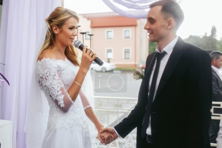 Beautiful bride and groom taking vows