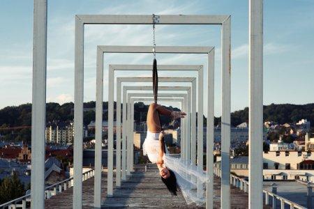 Brunette aerial hoop dancer