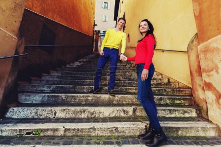 couple standing on the stairs in Rome