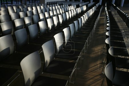 Photo for Endless rows of chairs in a modern conference hall - Royalty Free Image