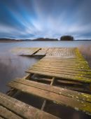 Lake with jetty. long exposure landscape