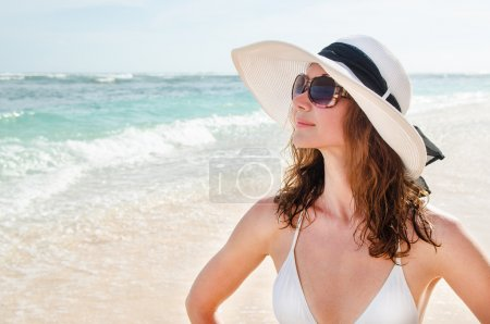 Young  woman on beach - Stock image