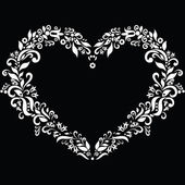 Embroidery inspired heart shape in white with floral elements on black background