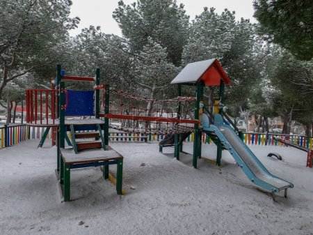 Photo for Snow in Madrid's children's park in January 2021 - Royalty Free Image