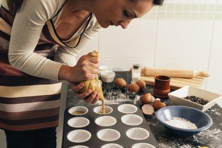 Beautiful woman Preparing Cookies