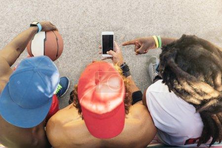 Multiethnic Friends Using Mobile.
