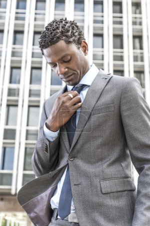african american business man adjusting his neck tie