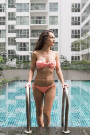 beautiful woman leave of the pool