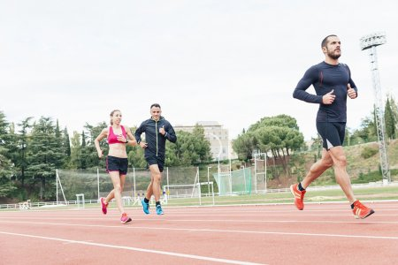 Photo for Group of young  athletics people running on the track field - Royalty Free Image