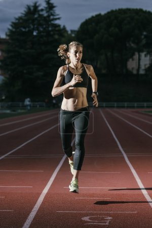 Attractive woman Track Athlete Running On Track