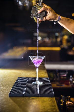 Photo for Expert barman is making cocktail at night club - Royalty Free Image