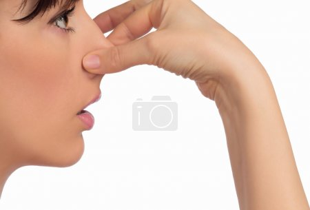 Image with woman's face holding her nose with hand...