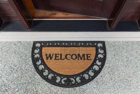 Welcome door mat with open door