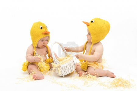Two babies in chicken costumes