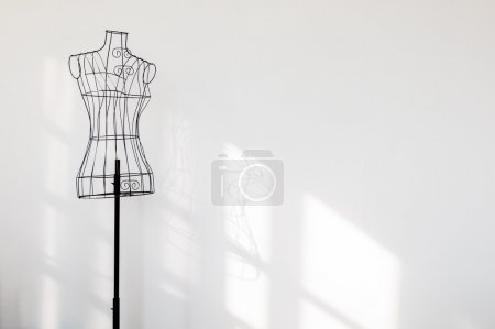 Photo for Vintage mannequin stand at white wall. - Royalty Free Image