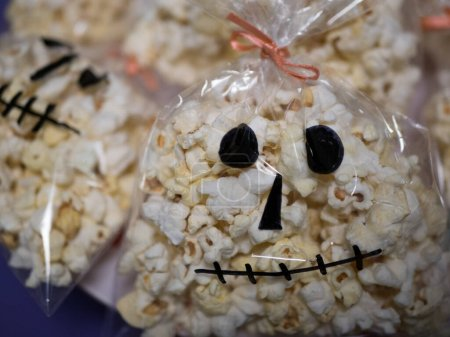 Photo for Halloween food, Bag with delicious popcorn in the form of skull - Royalty Free Image