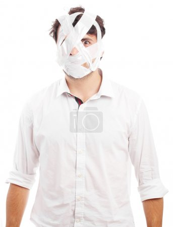 young man with head covered by tape