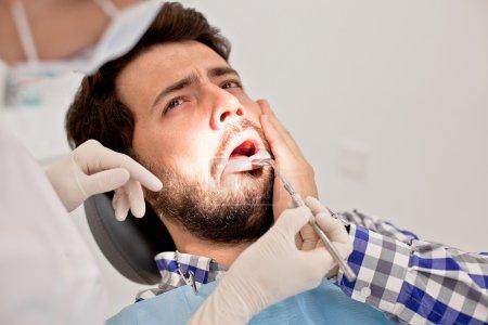 young man and woman in a dental examination at dentist
