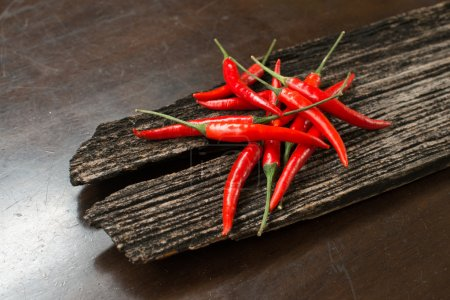 Red chillies on a plank