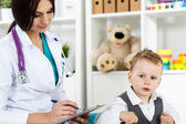 Pediatrician communicating with patient