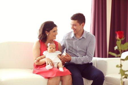 Parents enjoying their baby girl