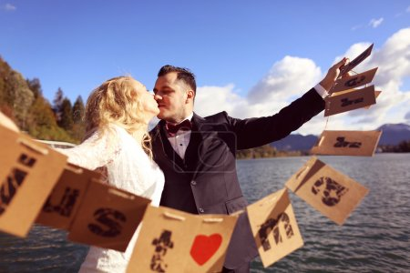 Bride and groom playing with Just Married cards