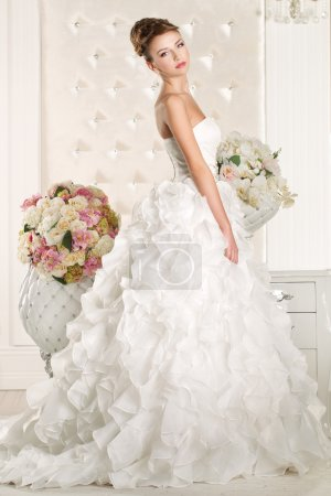 Photo for Gorgeous bride wearing a superb  white wedding dress - Royalty Free Image