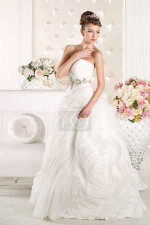 Gorgeous bride wearing a superb  white wedding dress
