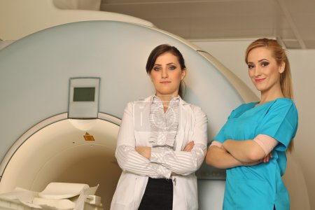 two Radiologic technicians smiling to the camera