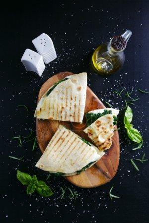 piadina with spinach and mozzarella. Italian healthy snack. stre
