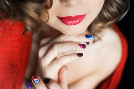 Portrait of a young curly girl with dark red lips  with manicure