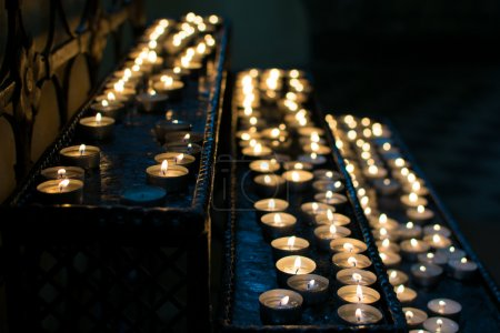 Candles in the catholic church of Vilnius (All Saints Church)